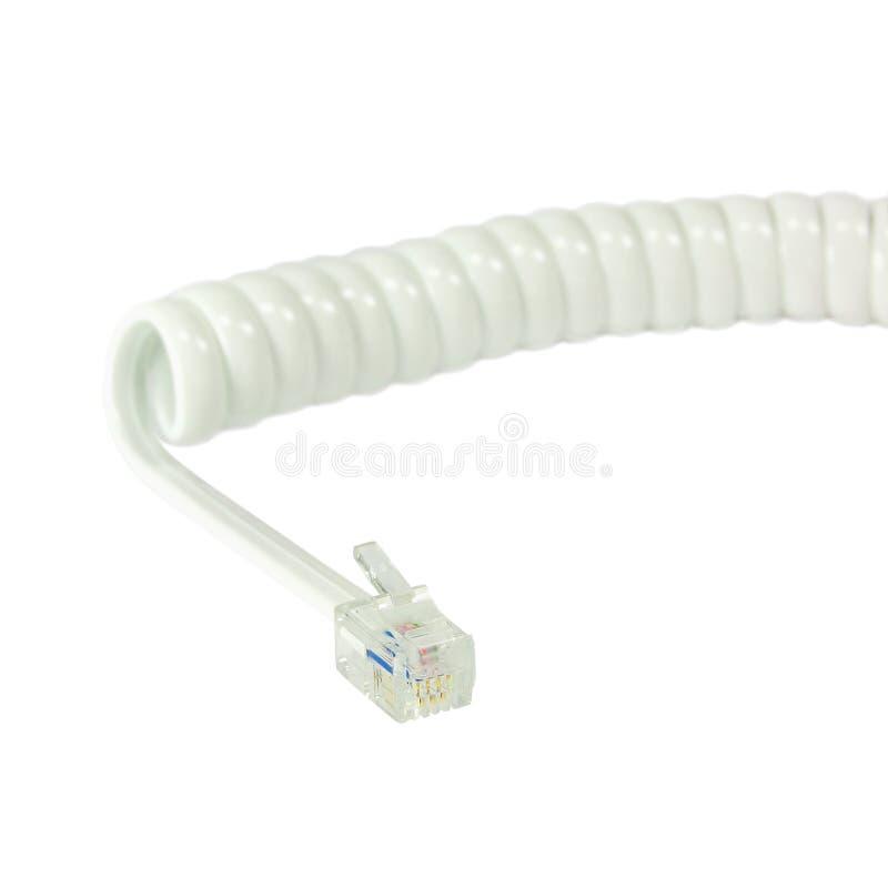白色分离的电话机延长绳路,卷曲卷线螺旋钢缆,被隔绝的4P4C RJ22连接器起重器 免版税库存图片