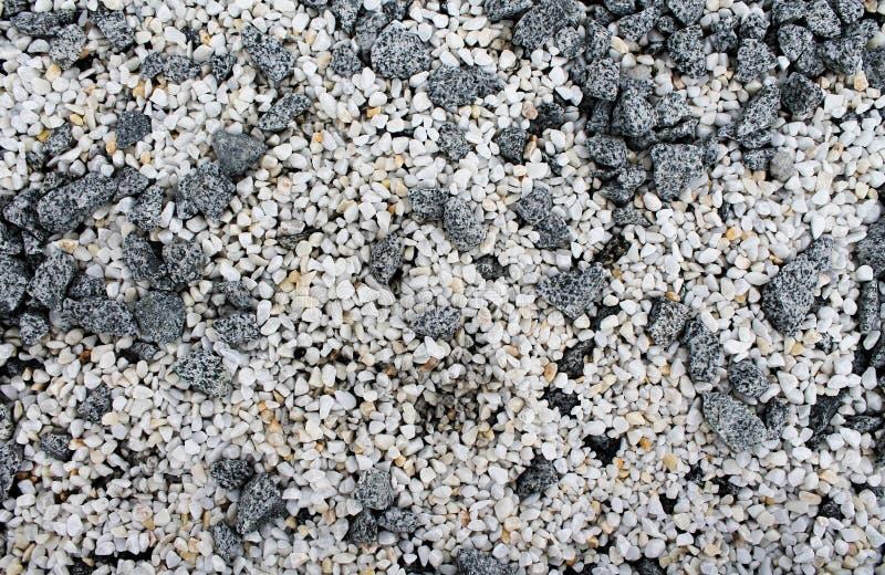 白色和灰色石头抽象背景 免版税库存照片