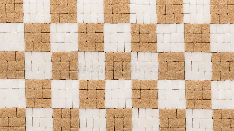 白色和红糖立方体创造性的背景 免版税库存照片