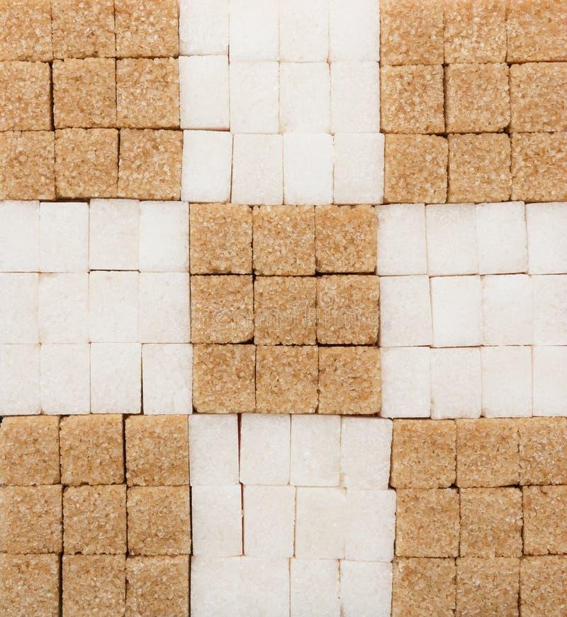 白色和红糖立方体创造性的背景 图库摄影