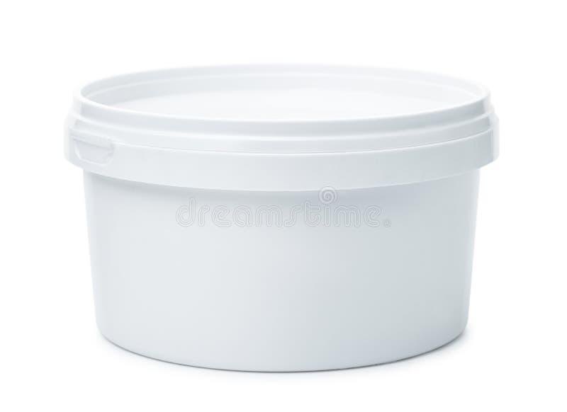 白色圆的塑胶容器 库存照片