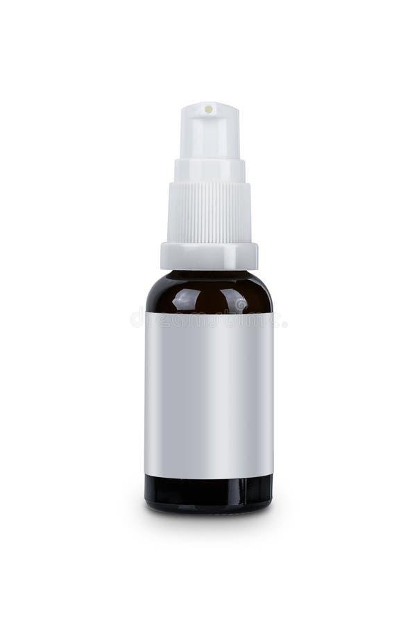 白色在白色背景与脸皮关心的分配器顶头泵体玻璃瓶化妆卫生学调节剂隔绝的 库存照片