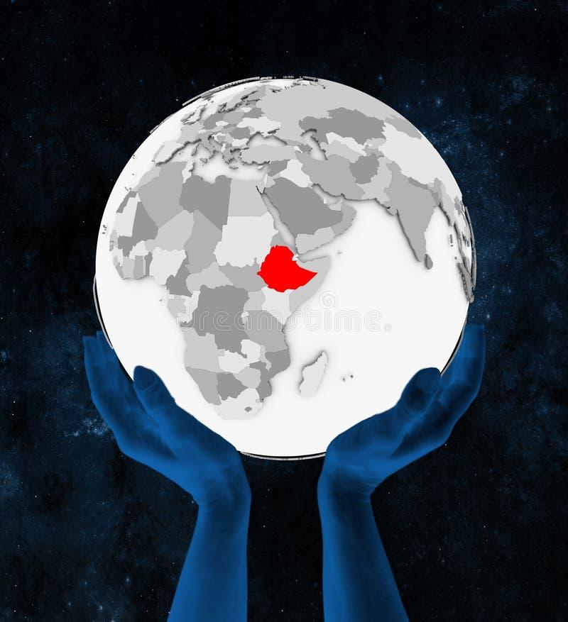 白色地球的埃塞俄比亚在手上 库存例证
