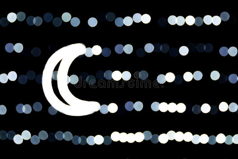 白色城市光抽象bokeh在黑背景的 defocused和弄脏与光月亮  库存图片