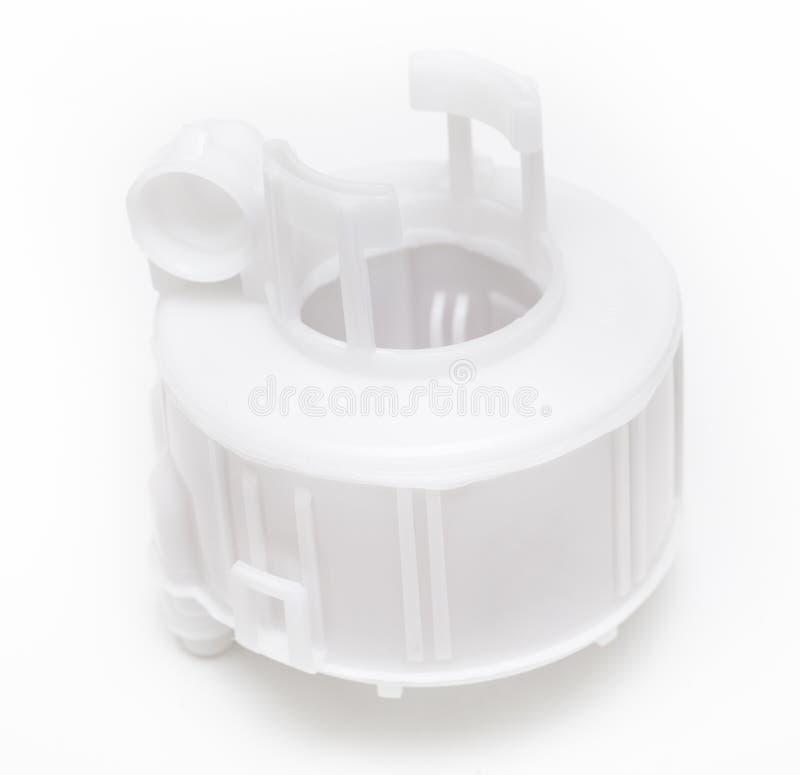 白色塑料汽油滤器,内在弹药筒在背景 免版税库存照片
