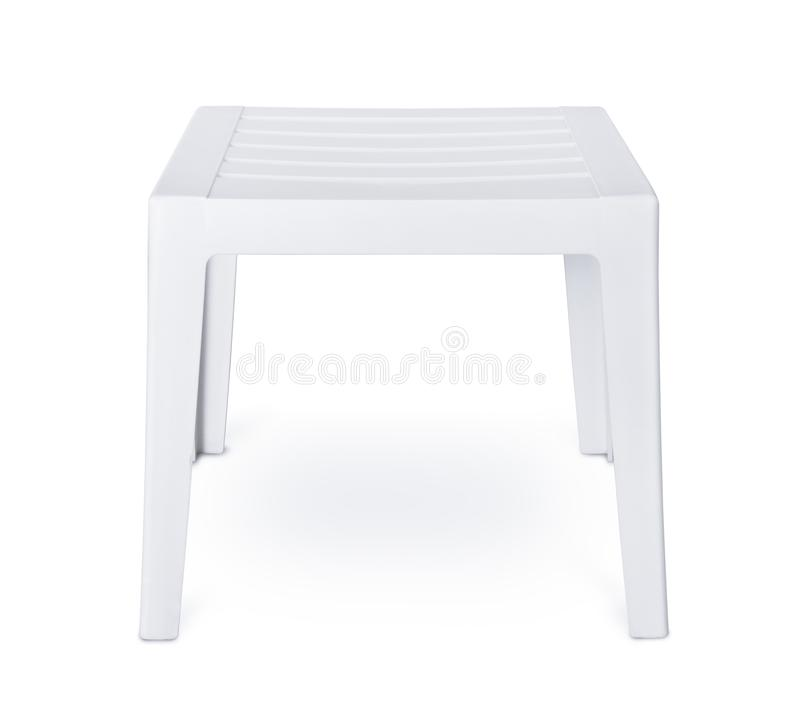 白色塑料露台边桌 免版税库存照片