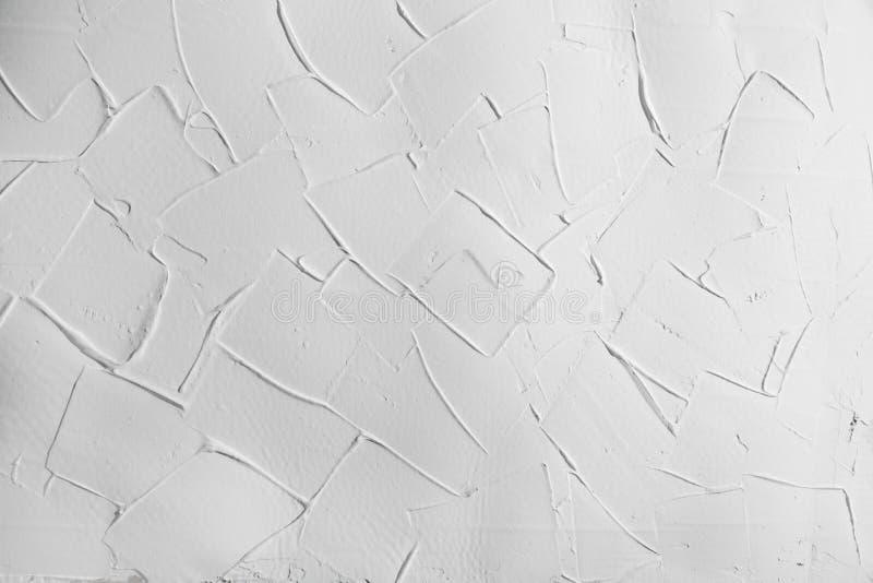 白色墙壁灰泥膏药纹理,与直角的背景 库存照片