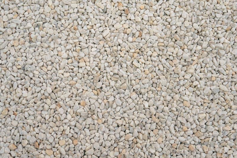 白色小岩石或石头表面纹理,工业石渣矿物材料,设计的背景作为背景 图库摄影