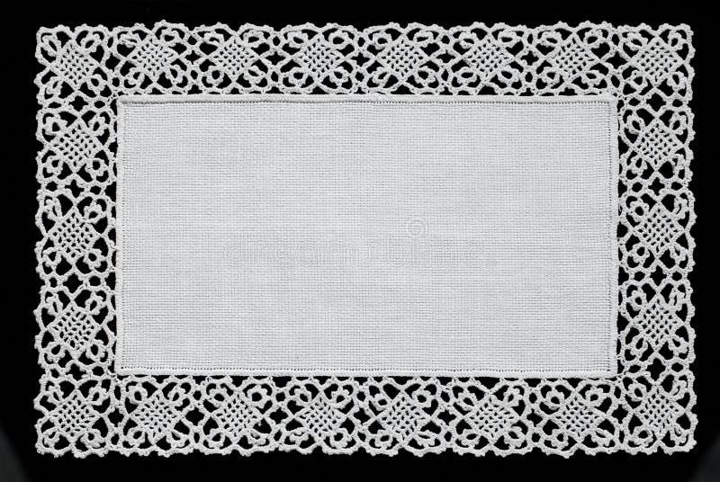 白色手工制造鞋带小垫布 免版税库存图片