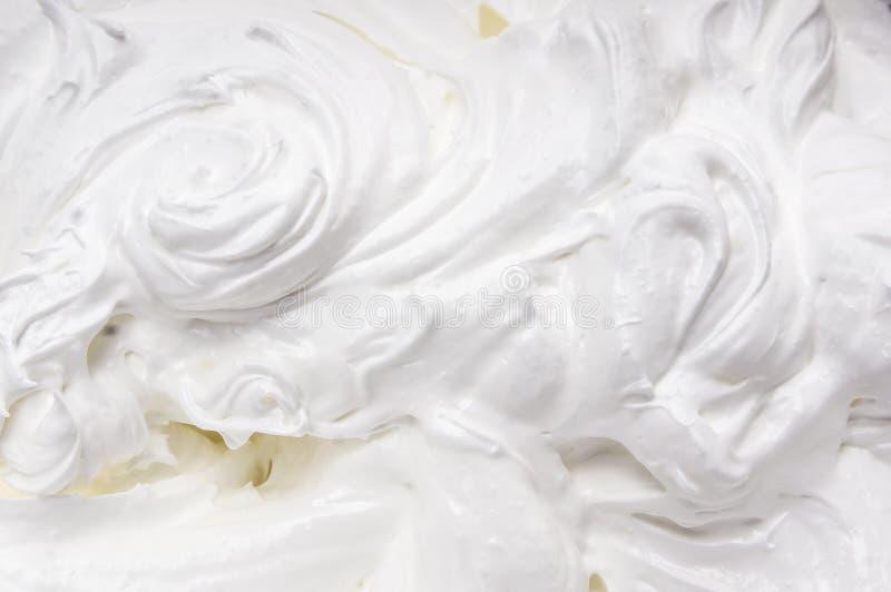 白色打好的奶油,食物背景 库存图片