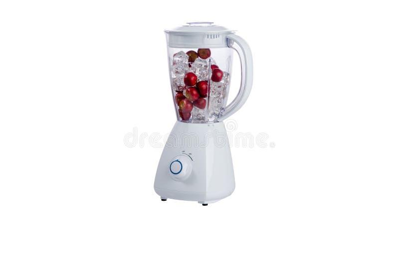 白色搅拌器有白色背景和莓果 库存照片