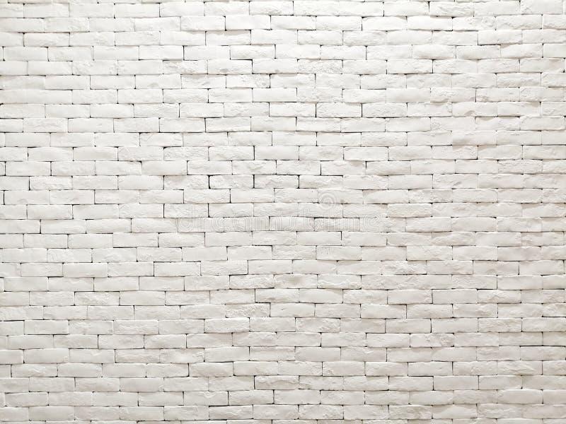 白色样式墙纸、背景和背景的黏土砖墙门面室内设计 图库摄影