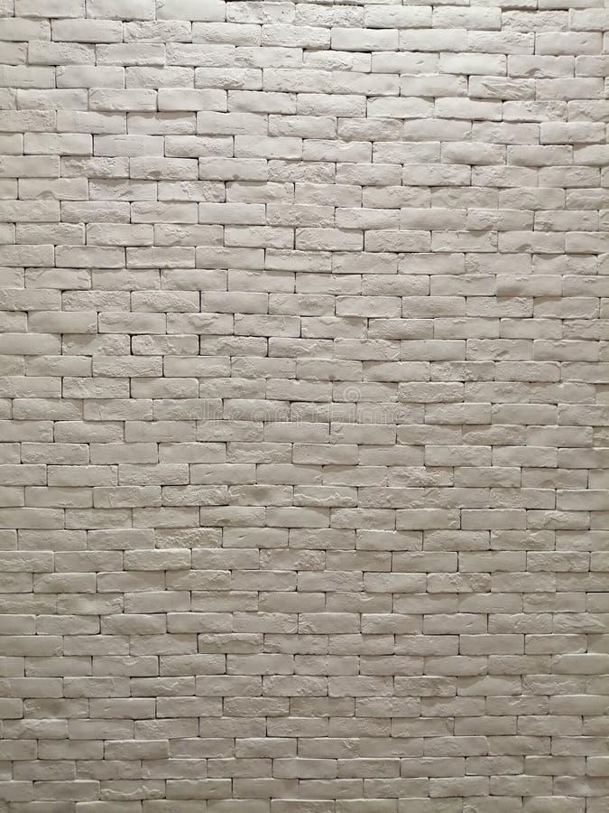 白色样式墙纸、背景和背景的黏土砖墙门面室内设计 库存照片