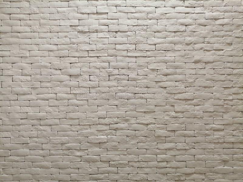 白色样式墙纸、背景和背景的黏土砖墙门面室内设计 免版税库存图片
