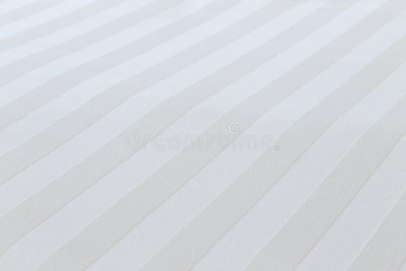 白色棉花板料背景的特写镜头 免版税库存照片