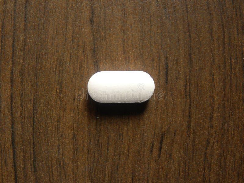 白色椭圆形医学片剂 免版税库存图片