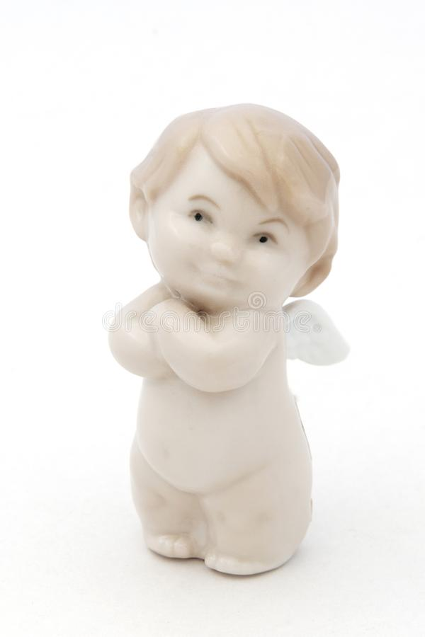 白色瓷天使小雕象 库存照片