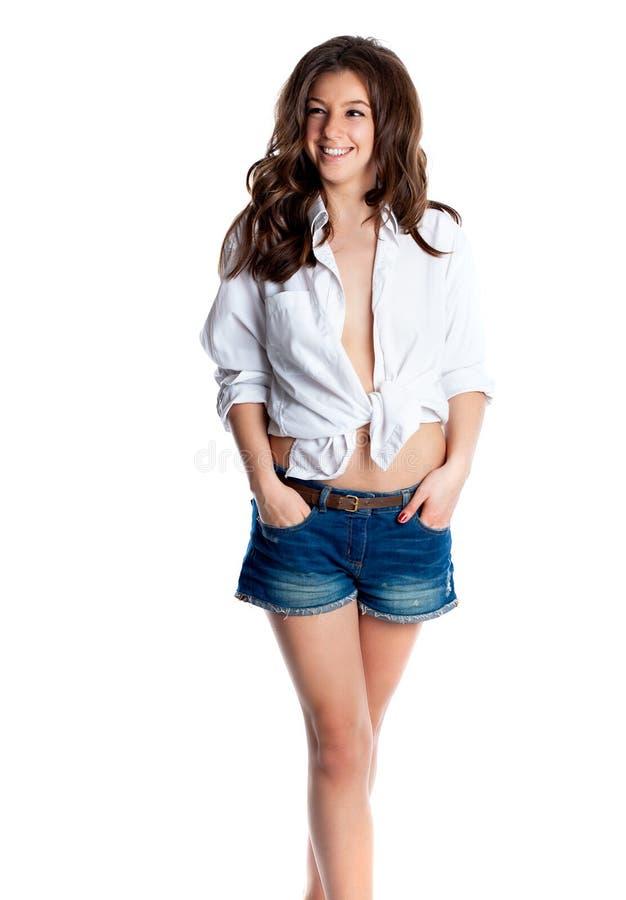 白色男性衬衣的肉欲的美丽的性感的妇女 查出在白色 免版税库存照片