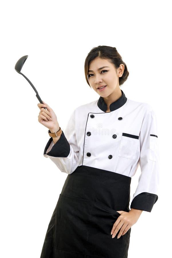白色的亚裔少妇厨师厨师 免版税库存照片
