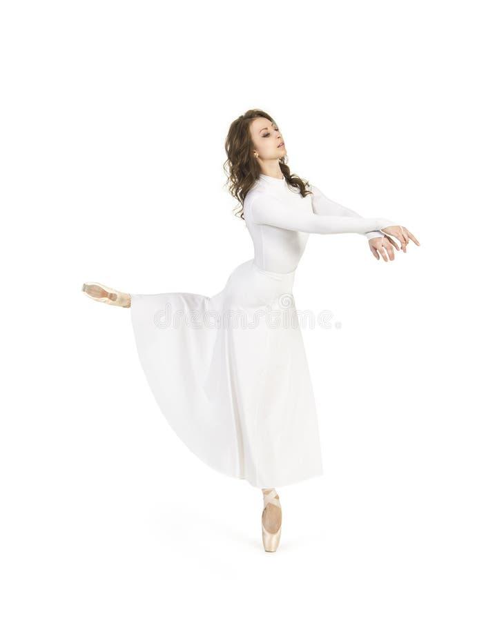 白色礼服跳舞的芭蕾的一个女孩 库存图片