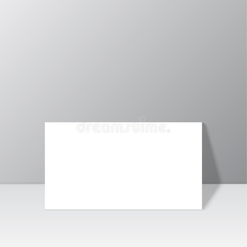 白色空白固定式在有阴影的墙壁附近 皇族释放例证