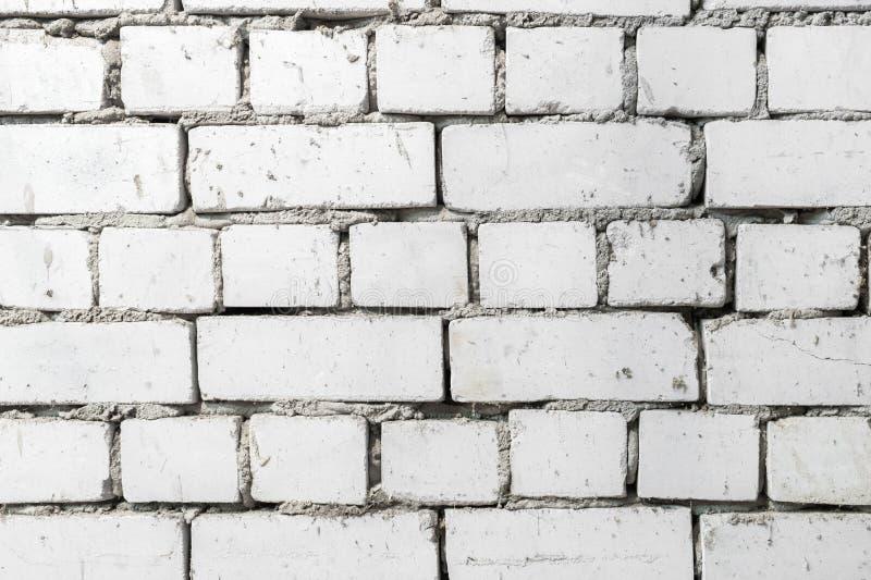 白色老石造壁 设计的背景 免版税库存照片