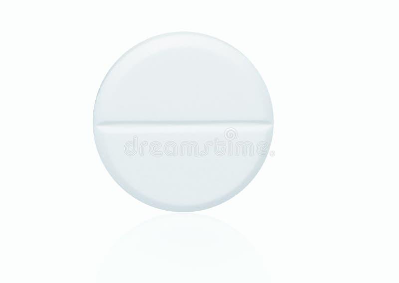 白色耐咀嚼的片剂药片宏观射击在白色背景的 库存图片