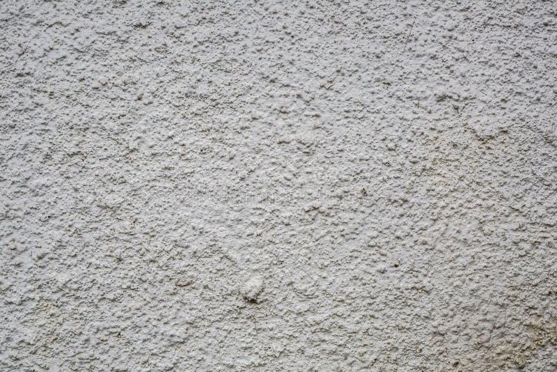 白色肮脏的概略的灰色石头混凝土墙纹理 免版税库存照片