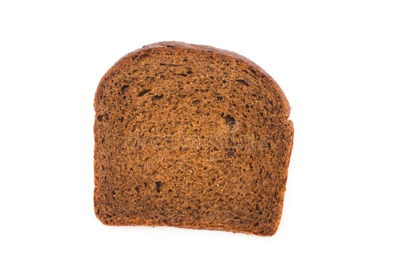 白色背景下从上面开始的一片全麦棕色面包 库存照片