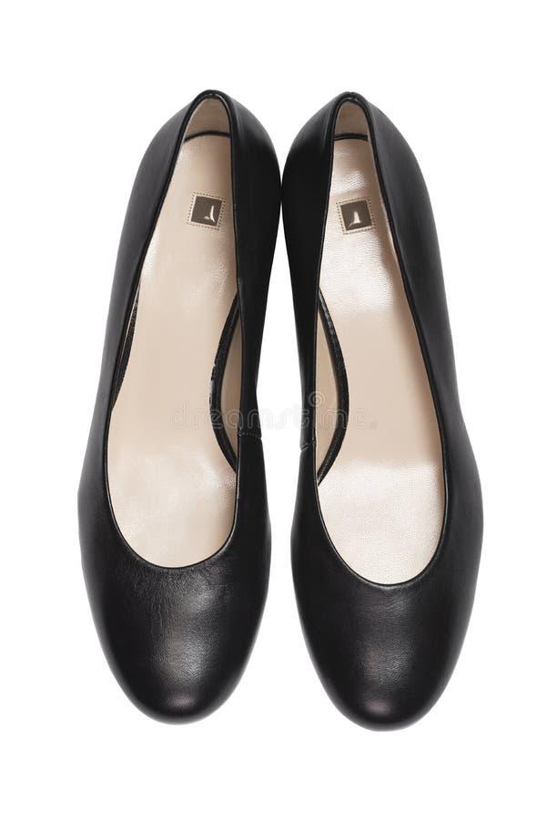 白色背景中时尚的高跟鞋,顶视图 平躺 免版税图库摄影