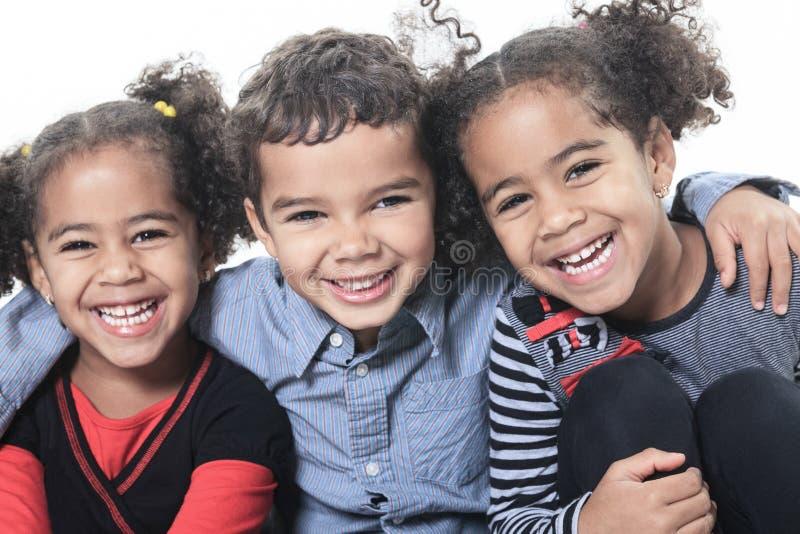 白色背景的一个逗人喜爱的非裔美国人 库存图片