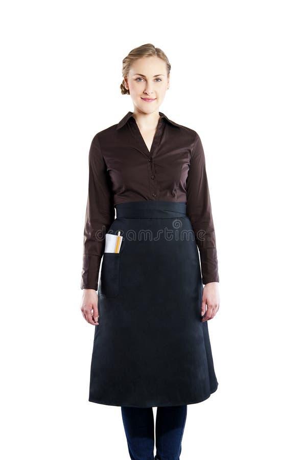白色背景的一位可爱的年轻女服务员 免版税库存照片