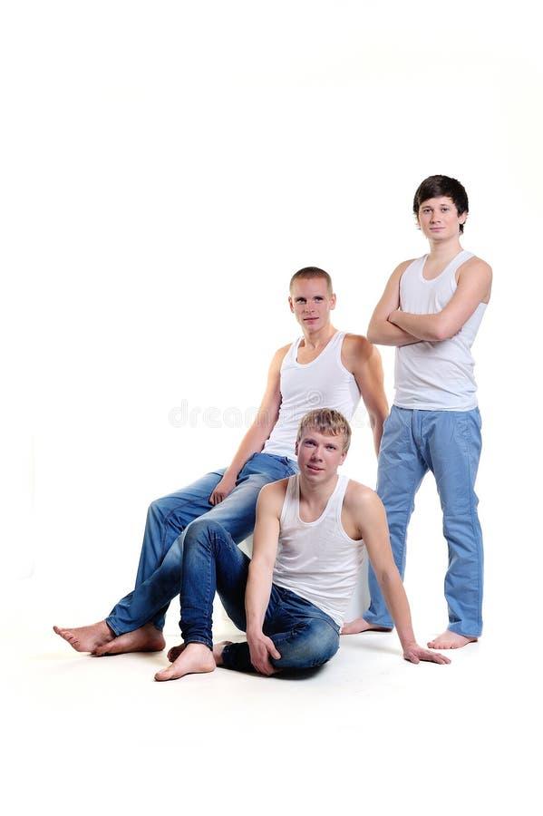 白色背景的三个人在演播室 库存照片