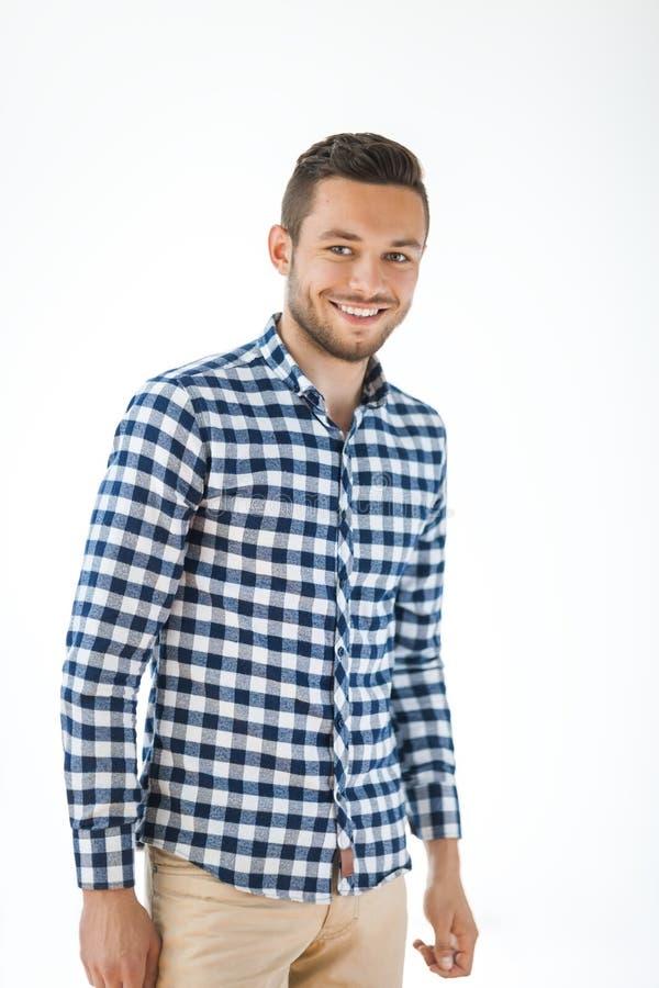 白色背景的微笑的英俊的人 免版税库存照片