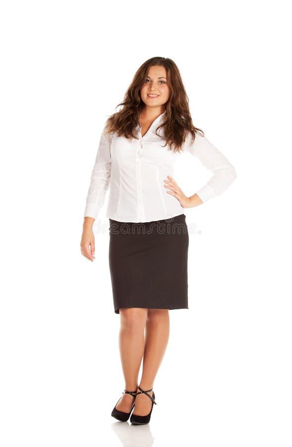 白色背景的迷人的年轻女实业家 免版税图库摄影