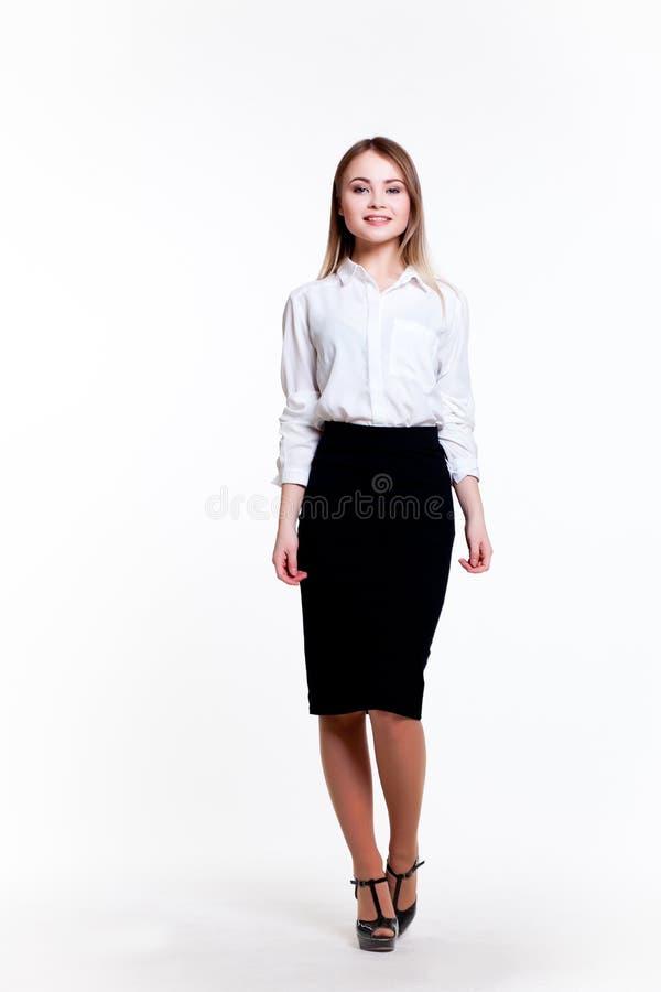 白色背景的年轻可爱的企业女孩 库存照片