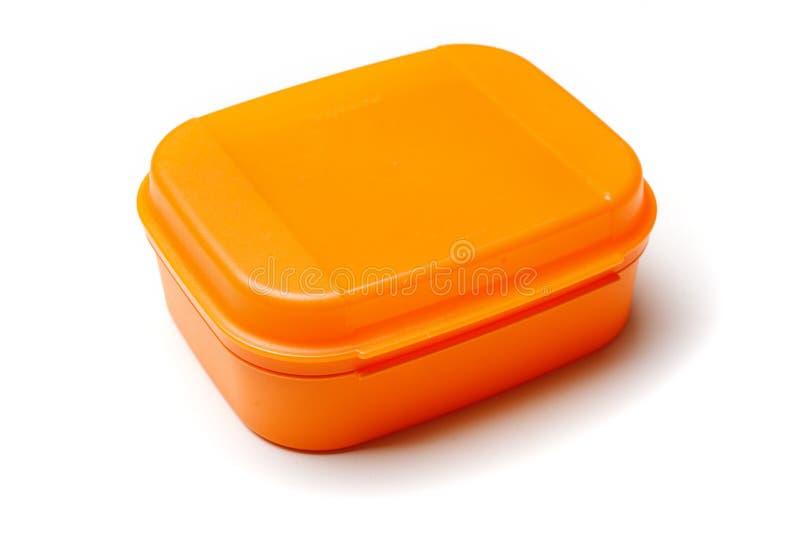白色背景隔离的橙色塑料食品容器 库存图片