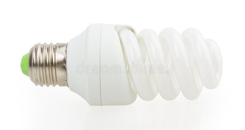 白色节能灯。在白色背景的例证。 图库摄影