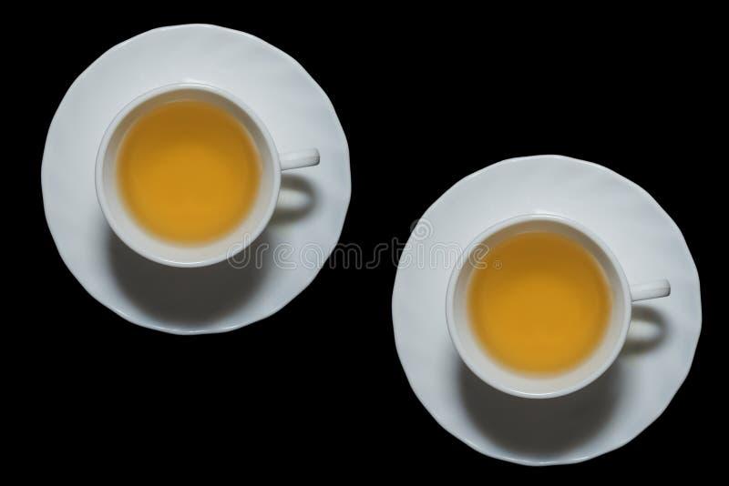 白色茉莉花茶s杯子在黑背景中 免版税图库摄影