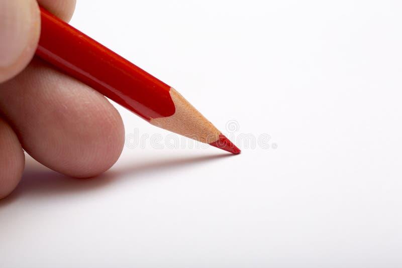 白色表面上的红色铅笔 免版税库存图片