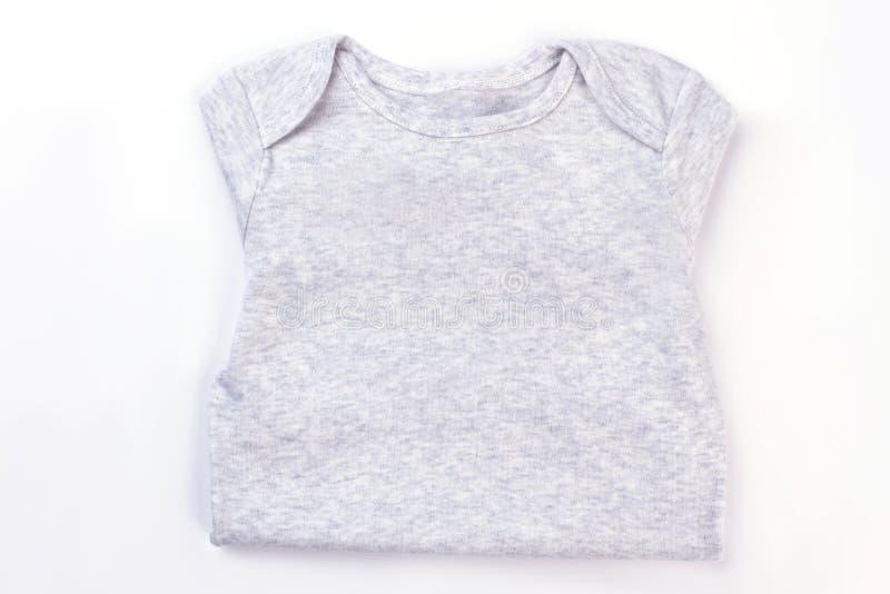 白色被折叠的棉花婴孩布料 图库摄影