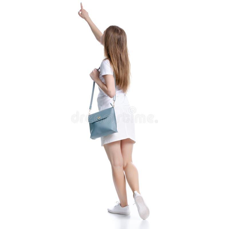 白色裙子和T恤杉的妇女有袋子陈列的 库存图片