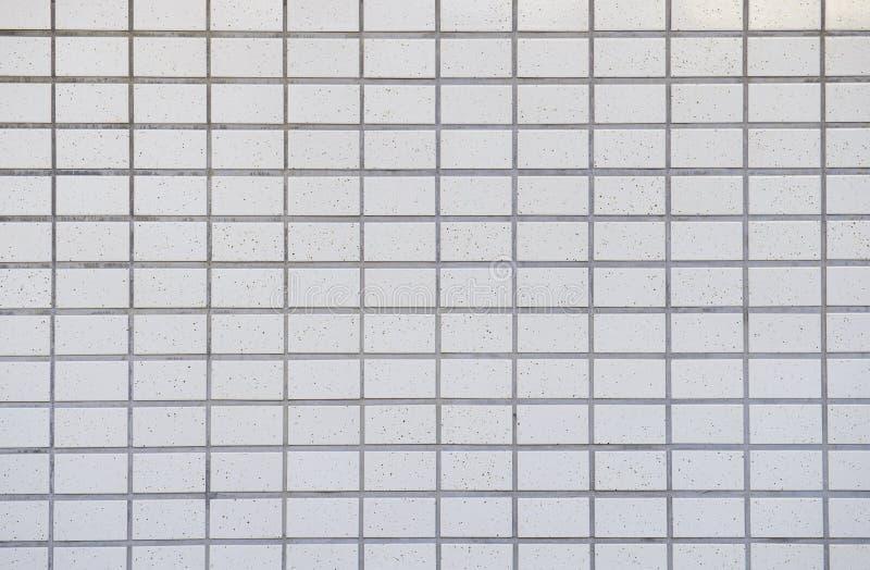 白色铺磁砖的墙壁背景 免版税库存照片