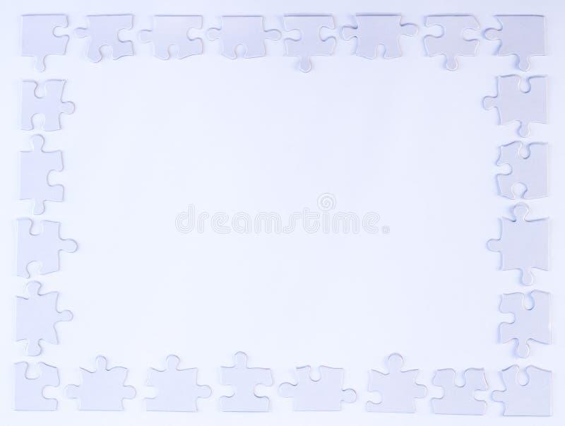 白色难题片断边界 免版税库存图片