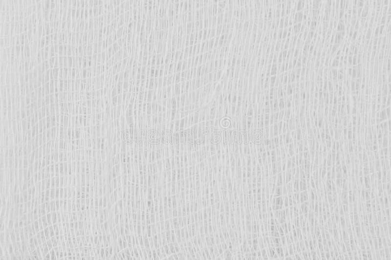 白色医疗绷带纱纹理,抽象织地不很细背景宏观特写镜头,自然棉花亚麻制织品水平的拷贝空间 免版税图库摄影