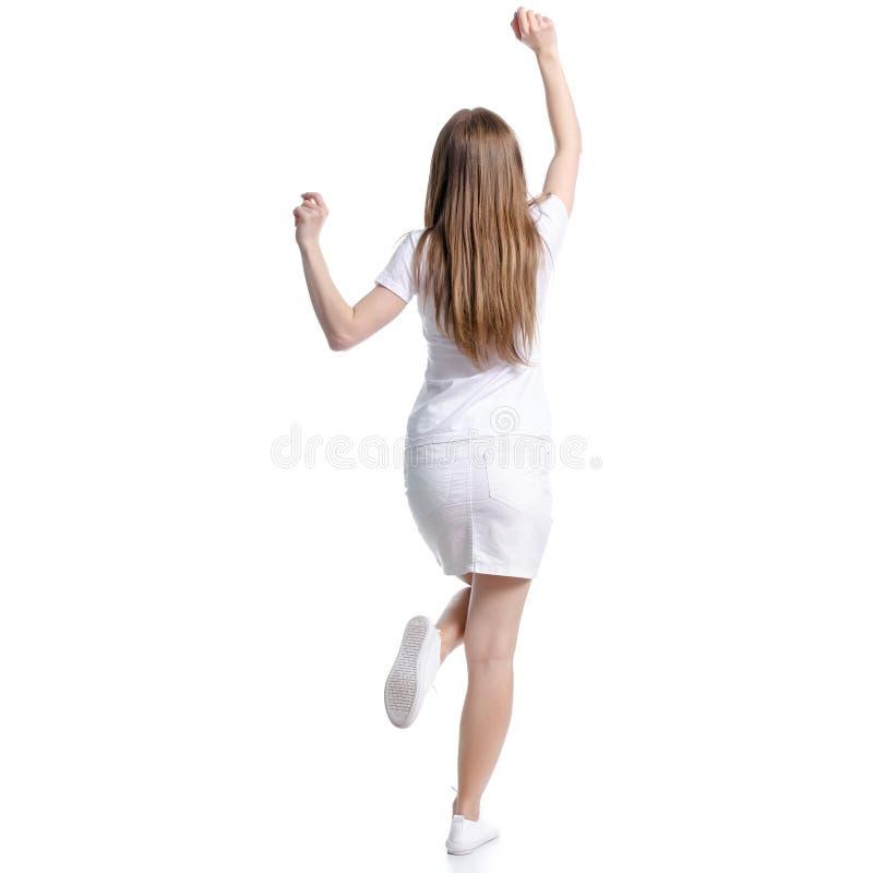 白色T恤和裙子幸福跳舞的妇女 库存照片