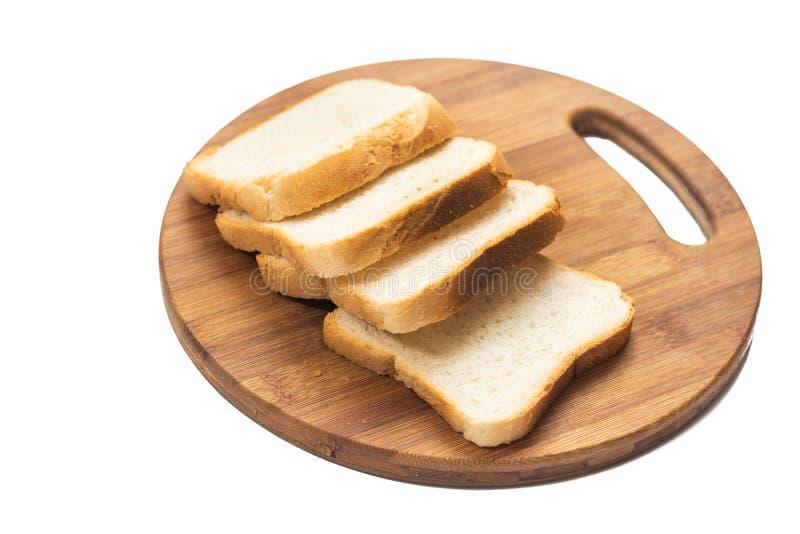 白面包在木切板的多士切片 库存照片