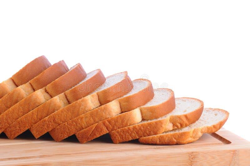 白面包大面包在切板的 库存图片