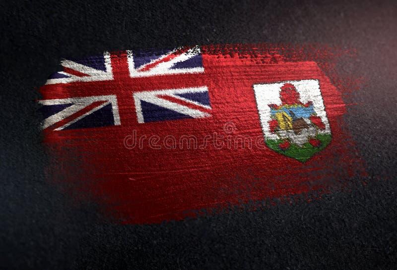 百慕大旗子由金属刷子油漆制成在难看的东西黑暗墙壁 免版税库存照片