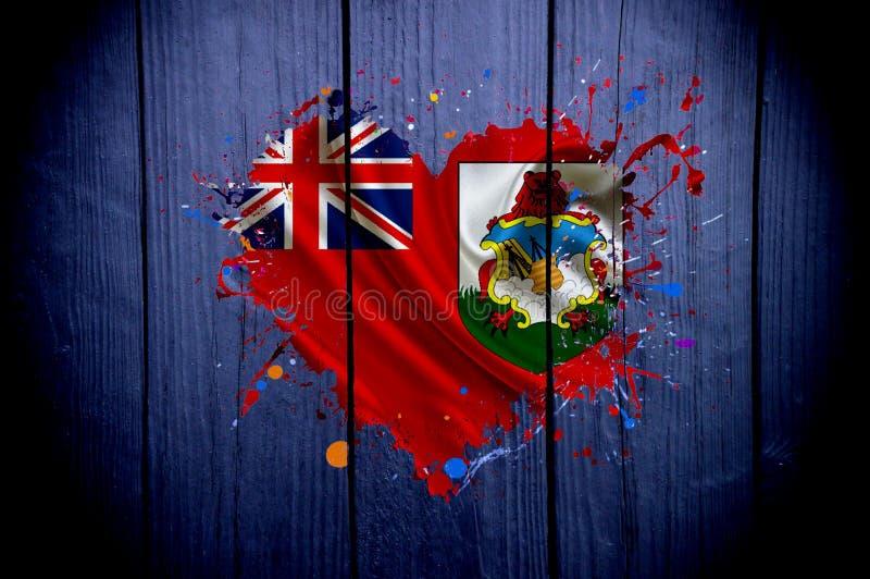 百慕大的旗子以心脏的形式在黑暗的背景 库存照片
